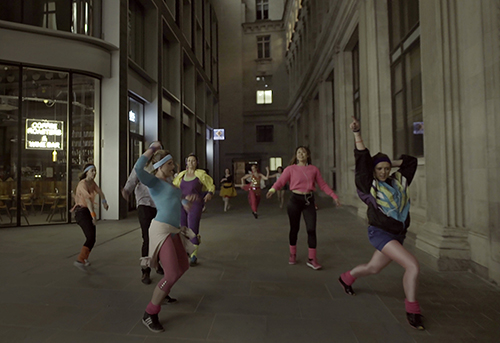 Dancers parade through the street in Melanie Manchot's Dance (All Night, London) 2017